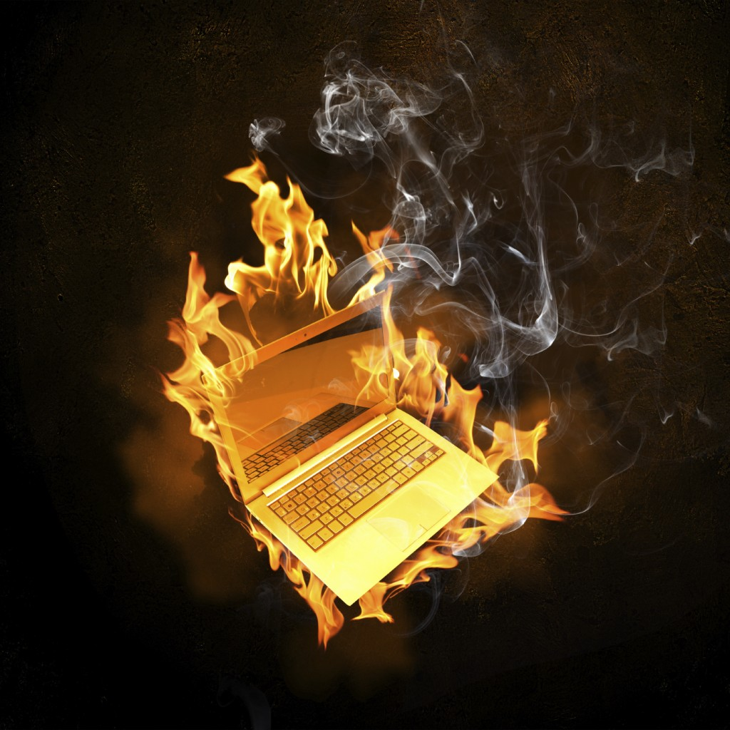Laptop in fire flames
